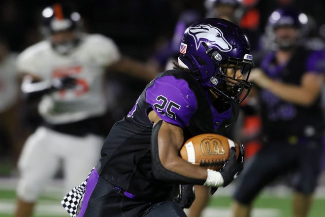 Burlington High School's Bryant Williams (25) moves the ball down the field during their season home opener against Washington High School Friday Aug. 27, 2021, at Burlington's Bracewell Stadium.