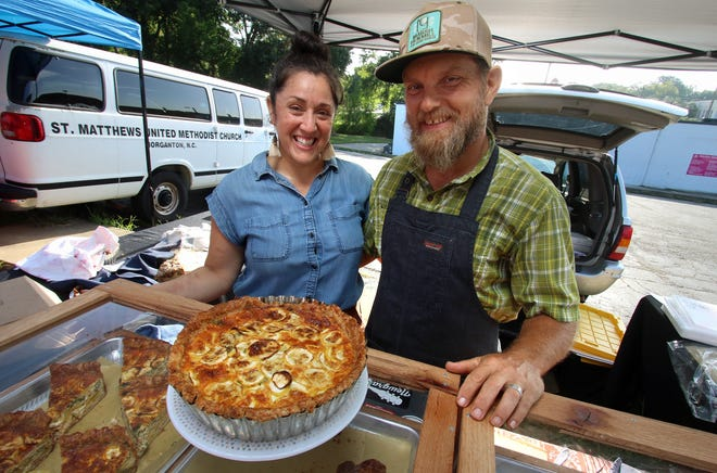 Keia Mastrianni and Jamie Swofford sell pies from their Milk Glass Pie booth at the Farmers Market in Shelby early Saturday morning, August 28, 2021.