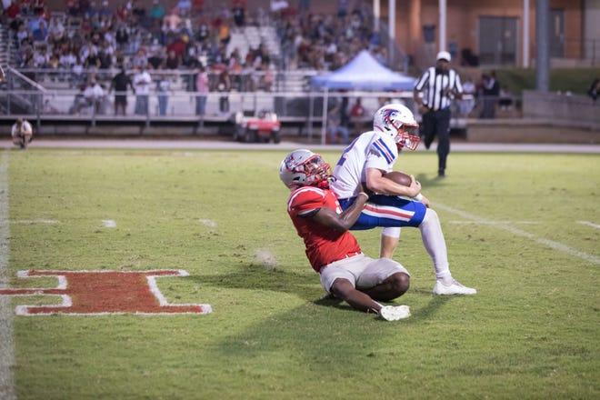 Hendersonville linebacker Elyja Gibbs gets a sack against West Henderson quarterback Truitt Manuel during their game earlier this season.