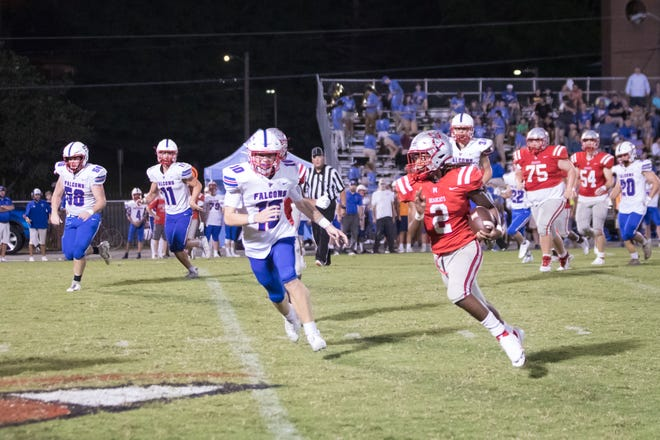 Hezzie Rudisill (2) is pursued by Gavin Russell late in the third quarter Friday night at Dietz Field. [PAT SHRADER/ SPECIAL TO THE TIMES-NEWS]