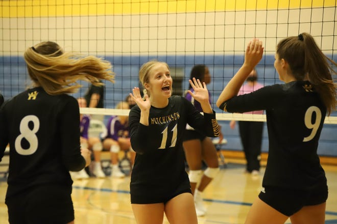 Hutchinson senior Kaitlin Yoder (11) high-fives sophomore Rachel Tomac (9) after the Salthawks score a point during the AVCTL preseason tournament Saturday, Aug. 28, 2021 at the Salthawk Activity Center at Hutchinson High School.
