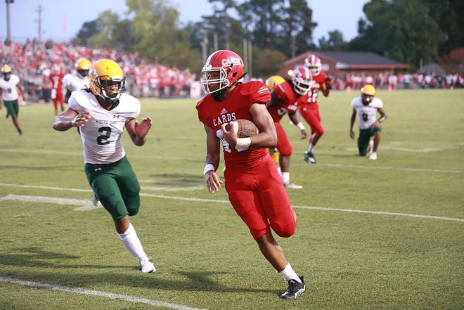 Jacksonville's Christian Constant runs for a big gain in the Cardinals' 48-6 win over White Oak on Friday night.
