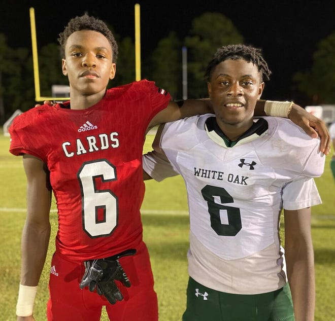 Jacksonville's Noah Gibson, left, and White Oak's Amir Sanders have been friends since their recreational football days. Gibson, however, has some bragging rights over his friend after his Cardinals defeated the Vikings 48-6 on Friday night.