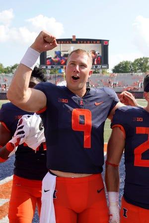 Illinois quarterback Artur Sitkowski celebrates the team's 30-22 win over Nebraska after an NCAA college football game Saturday, Aug. 28, 2021, in Champaign.