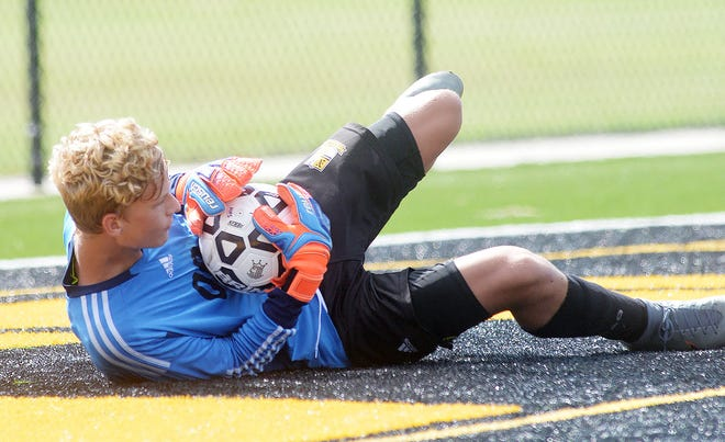 Newton freshman goalkeeper Abram Wall made his varsity debut with four saves in a 0-0 tie against McPherson.