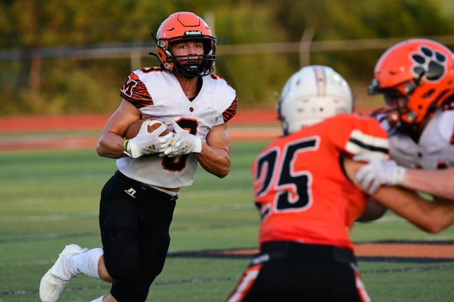 Macon receiver Chrisjen Riekeberg runs after a catch during the first quarter of Friday's game between Macon and Kirksville. He finished with 11 catches for 175 yards and two touchdowns.