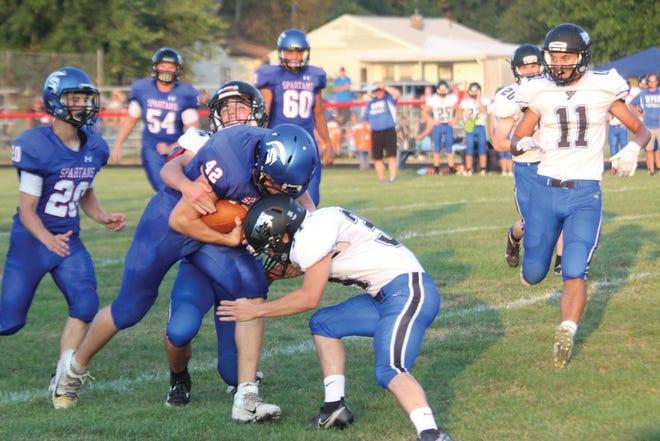 B-PC's Shane Shinn runs over a tackler.