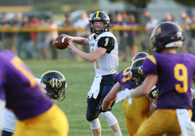 Whiteford's Shea Ruddy looks to pass during the Bobcats' 52-21 win over Blissfield last week. The Bobcats will play Ida this week for the first time since 1976. A new playoff system for high school football in Michigan helped make the matchup possible.