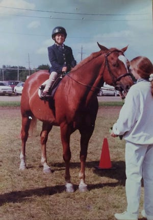 A young James Pershing rides a horse at a Stepping Stones event.