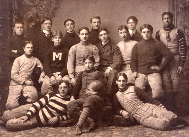 This photo shows members of the Monroe High School football team, circa 1899. The first Monroe Union School was built in 1858 and rebuilt in 1888 following a fire.