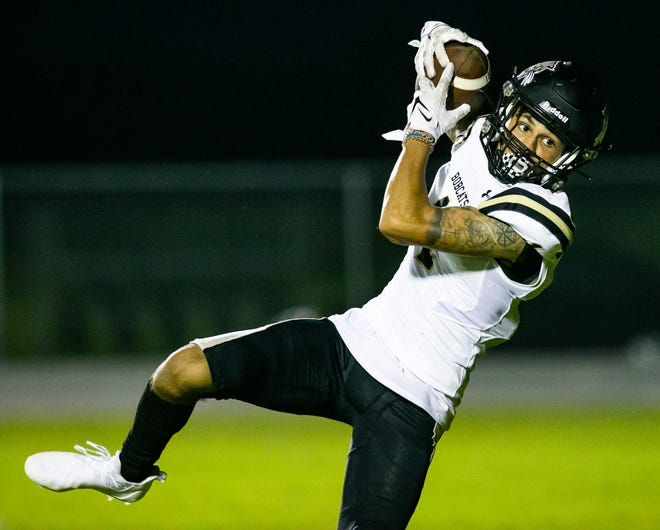 Buchholz High's Adrian Sermons catches a pass in the end zone Friday for a touchdown to make it 27-0 Bobcats before the extra point. Buchholz defeated the Dunnellon Tigers 35-0 at Dunnellon.