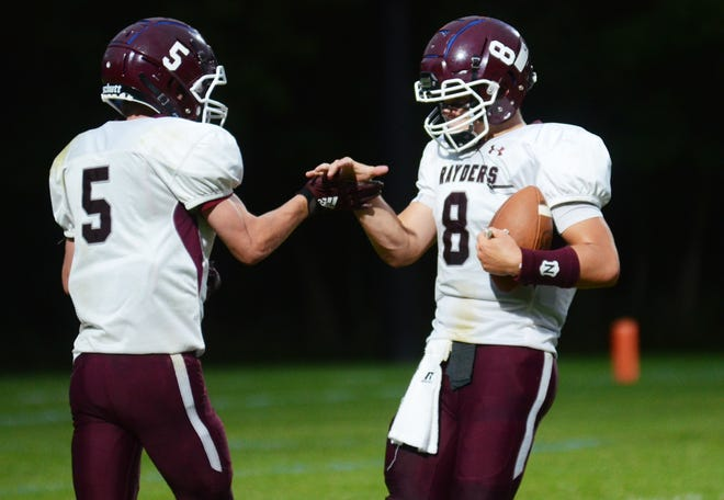 Charlevoix's Max Ostrum (5) and Caleb Stuck (8) celebrate their touchdown in the first half of Friday's game at Harbor Springs.
