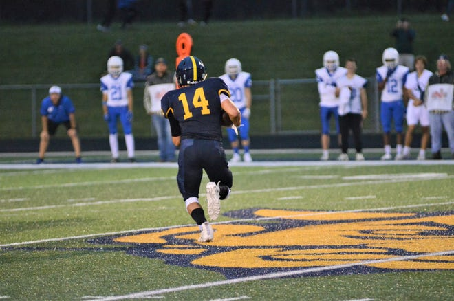 Senior Austin Vanderveer carries the football for Gaylord in their 27-7 defeat. Vanderveer led all rushers with 73 yards and accounted for the team's lone touchdown.