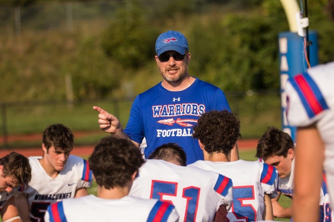 Winnacunnet High School football coach Ryan Francoeur talks to his team at halftime of Friday's scrimmage against Nashua South. The Warriors advanced to last year's Division I semifinal and look to take that last step this season.
