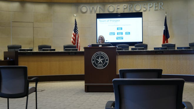 Betty Pamplin explained each item on the budget to the attendees and those on Zoom.