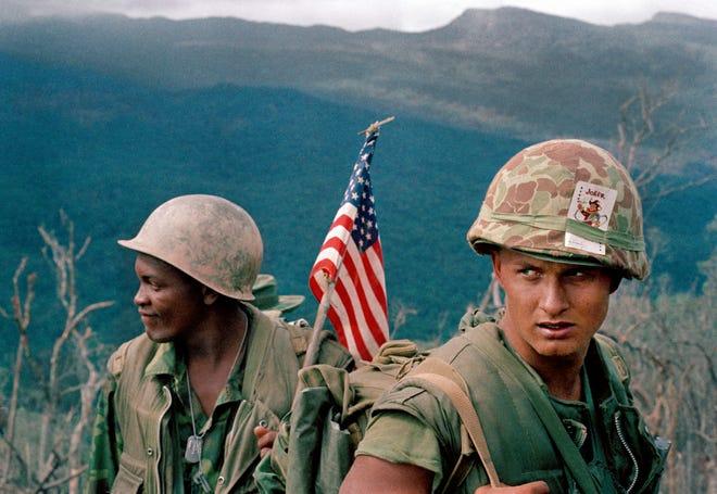U.S. Marines move through a landing zone in December 1969.