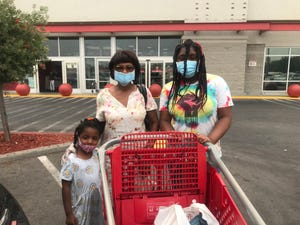Lessie Tanson, shopping at Stockton's Target with granddaughters Daisy, 11, and Abigail, 4, is worried about their return to school because of the coronavirus but appreciates the mask mandates from Gov. Gavin Newsom's administration.