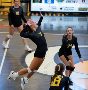 Garfield's Gabby Barnard leaps for a spike in Saturday's victory over Rootstown.