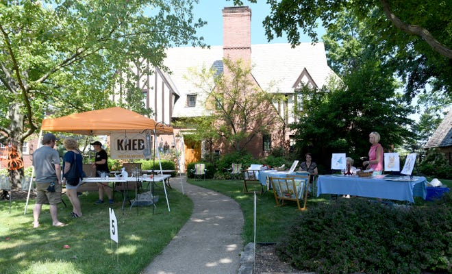 Artwork for sale on 23rd Street NW in Canton during The Historic Ridgewood Artists' Showcase & Sale on Saturday.