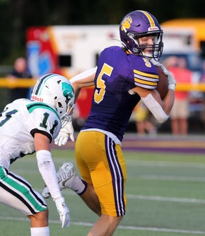 Mack Kistler, 5, of Jackson looks over his shoulder after catching a deep pass as Vince Caspio, 11, of Mayfield gives chase during their game at Jackson on Friday, August 27, 2021.