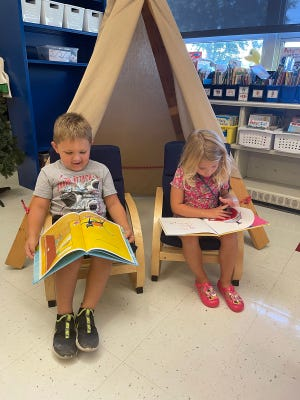 Harrison and Kensley read their books in Sarah Burnett's kindergarten classroom.