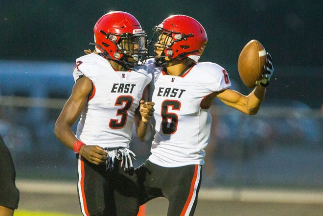 East's Javius Catlin, right, celebrates a touchdown against Belvidere North in the second quarter of their NIC-10 game on Friday, Aug. 27, 2021, at Belvidere North High School in Belvidere.