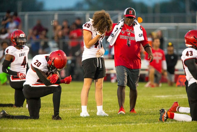 Corbin Hada wears his brother's No. 45 jersey and stands at his defensive position during a moment of silence to honor Mason Hada, 16, in the first quarter of their NIC-10 game on Friday, Aug. 27, 2021, at Belvidere North High School in Belvidere. Hada was struck and killed in a vehicle collision on Thursday evening. Friday's game would have been his first as a varsity member.