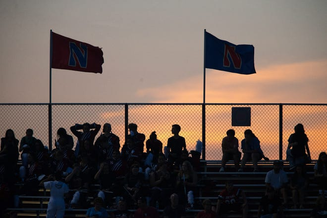 The sun sets behind the Belvidere North bleachers in the first quarter of their NIC-10 game against East on Friday, Aug. 27, 2021, at Belvidere North High School in Belvidere.