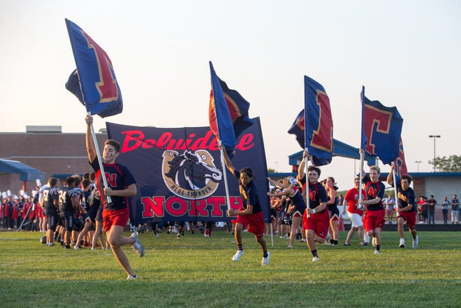 Belvidere North varsity football players enter the field before their first game of the season on Friday, Aug. 27, 2021, at Belvidere North High School in Belvidere.