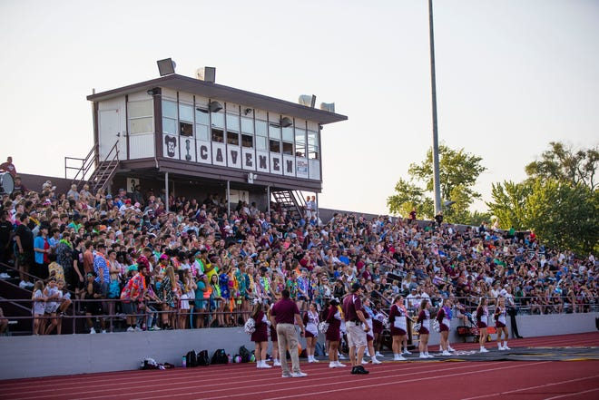 Fans watch during the Mishawaka vs. Elkhart High School football game Friday, Aug. 27, 2021 at Mishawaka High School.