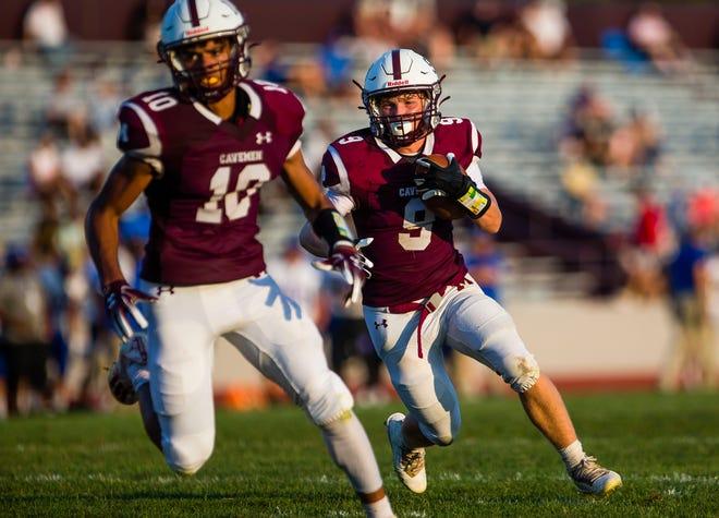 Mishawaka's Chaz Hardy runs the ball during the Mishawaka vs. Elkhart High School football game Friday, Aug. 27, 2021 at Mishawaka High School.