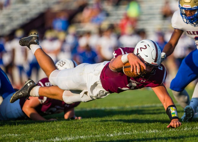 Mishawaka's Justin Fisher dives for a touchdown during the Mishawaka vs. Elkhart High School football game Friday, Aug. 27, 2021 at Mishawaka High School. Fisher left Friday's game at Goshen after suffering an apparent leg injury in the first quarter.