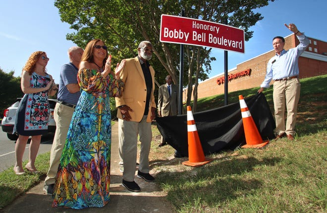 Shelby Mayor Stan Anthony, right, says a few words as Pam and Bobby Bell stand near by as the city  unveiled a sign changing North Dekalb Street to Bobby Bell Boulevard near East Grover Street in Shelby Saturday morning, August 28, 2021.
