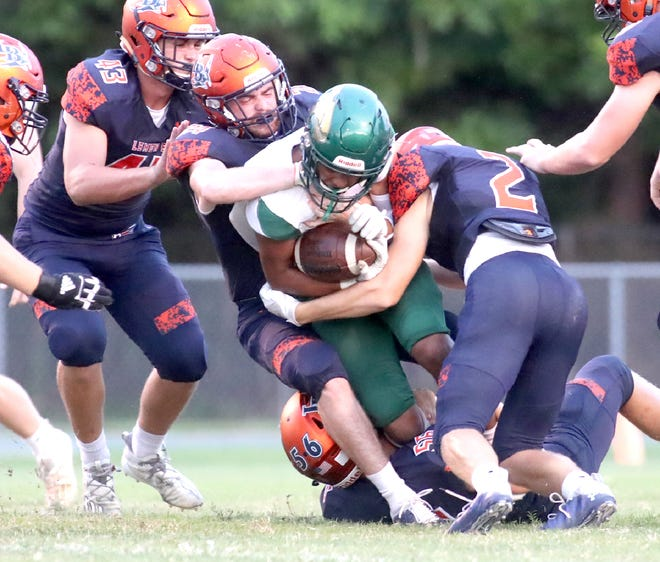 Joseph Hackett leads a swarming Lemon Bay High defense to bring down a Saint Stephen's ball carrier during the opening week of the regular season at Veterans Stadium in Englewood on Aug. 28.