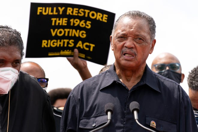 In this Aug. 2 photo, the Rev. Jesse Jackson speaks to a crowd during a demonstration supporting voting rights on Capitol Hill. Jackson and his wife, Jacqueline, were hospitalized Aug. 21 with COVID-19.