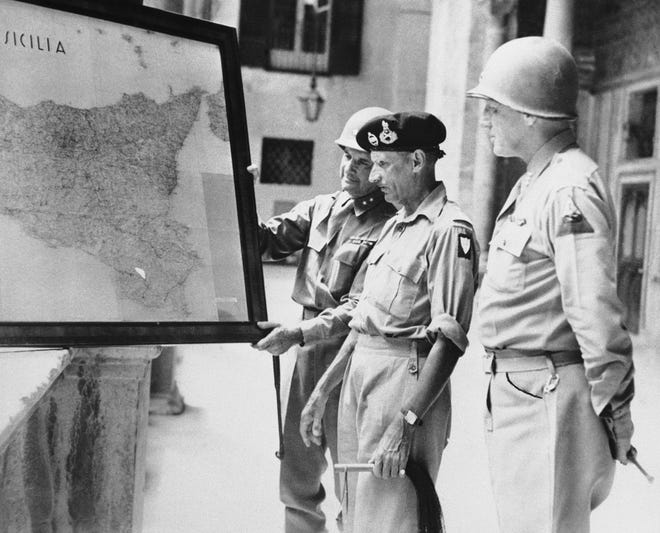 Allied commanders study a huge map of Sicily at the Royal Palace in Palermo, Italy, on Sept. 2, 1943. From left to right: Maj. Gen. Geoffrey Keyes, Gen. Bernard Montgomery and Lt. Gen. George S. Patton.