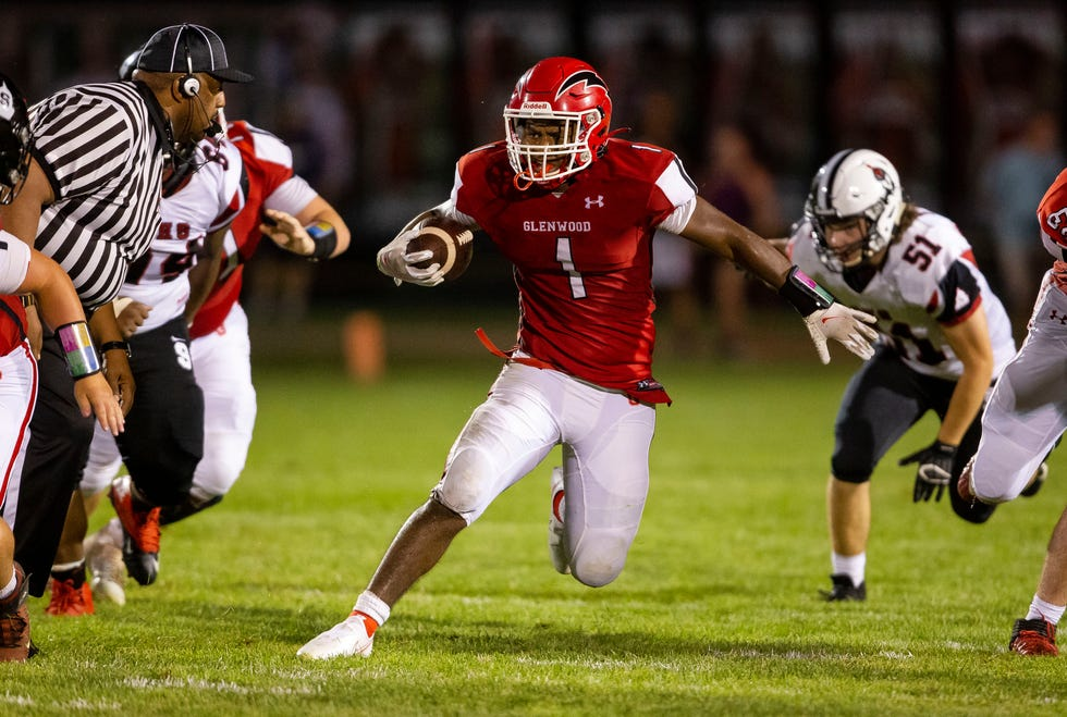 Glenwood's Jamarion Smith (1) cuts back on a Springfield defender on a rush in the second half at Glenwood High School in Chatham, Ill., Friday, August 27, 2021. [Justin L. Fowler/The State Journal-Register]