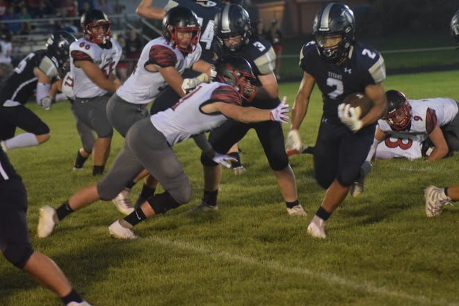 Annawan-Wethersfield's Darius Dickerson gains yardage on a sweep during the second half of Friday's game against United.