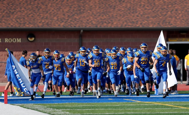 Aberdeen Central runs onto the field for their season opener at the 19th Hub City Bowl at Swisher Field on Friday. American News photo by Jenna Ortiz, taken 08/27/2021.