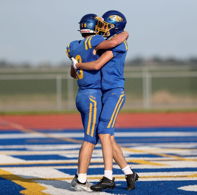 Aberdeen Central quarterback Sam Rohlfs embraces wide receiver Jacob Merxbauer after Rohlfs rushed in for a touchdown during the second quarter at the 19th Hub City Bowl at Swisher Field on Friday. American News photo by Jenna Ortiz, taken 08/27/2021.