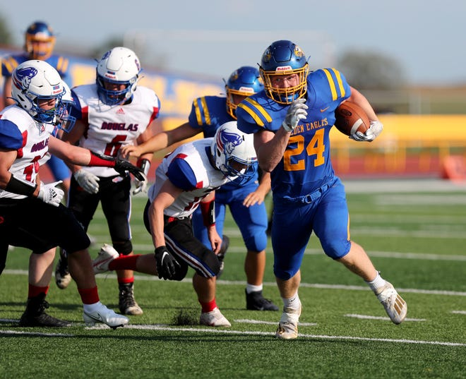 Aberdeen Central running back Karson Carda breaks free against Douglas for a 20-yard touchdown run during the second quarter at the 19th Hub City Bowl at Swisher Field on Friday. American News photo by Jenna Ortiz, taken 08/27/2021.
