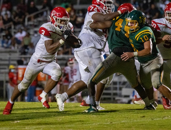 With Nic Bailey (74) and Ashton Williams anchoring the offensive line, Seventy-First running back Anthony Quinn Jr. (3) rushed for 111 yards and two touchdowns against Pine Forest.