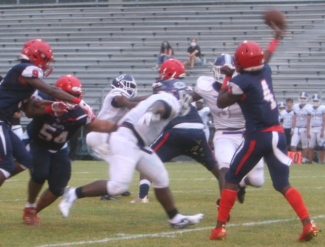 Vanguard sophomore quarterback Fred Gaskin throws a 54-yard touchdown pass to Tyrell Randall during the first quarter of Friday night's game against Gainesville High at Booster Stadium.
