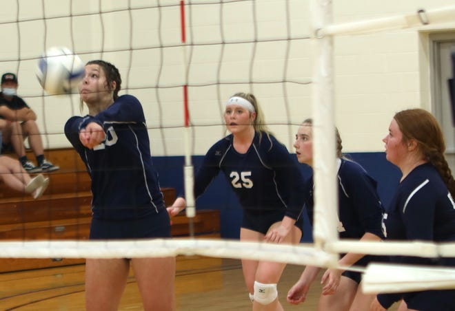 Lilli Peterson bumps the ball over the net against Clark State.