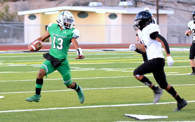 Victor Valley's Corinthians Jones scrambles with the football during the first quarter against Hesperia at Ray Moore Stadium on Aug. 27, 2021.