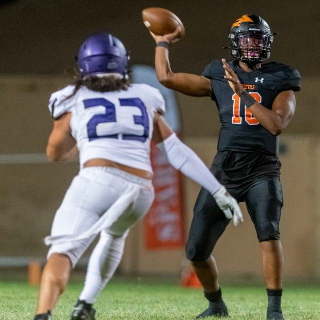 Apple Valley's Jayden Denegal throws a touchdown pass over Rancho Cucamonga's Jaylen Martin during the third quarter at Newton T. Bass Stadium on Aug. 27, 2021.