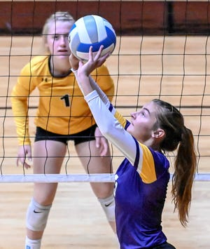 Watertown's Karli Hanten set the ball in front Mitchell's Paige Guthmiller during a match during the Huron Tiger Invitational volleyball tournament on Saturday in Huron.