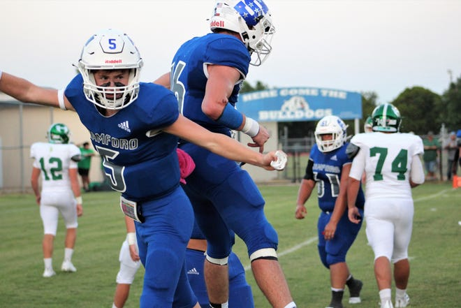 Stamford players Hayden Henager (5) and Dylan Faulks (16) celebrate a Bulldogs touchdown in the second quarter. Stamford fell behind 6-0 but scored twice to take a 14-6 halftime lead over Hamlin, going on to win 38-6 at Bill Anderson Stadium in Stamford on Friday.