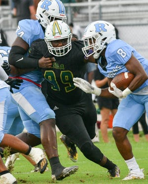 Jamari Lyons of Viera (99) fights through the block to get to Rockledge ballcarrier Lavatus Watkins during their game August 27, 2021. Craig Bailey/FLORIDA TODAY via USA TODAY NETWORK