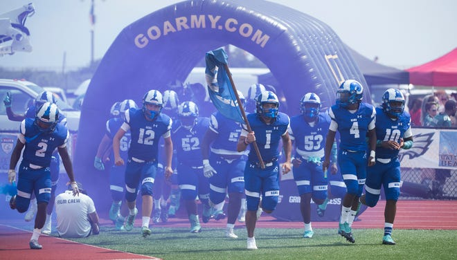 The Salem High School football team enters the field prior to the Battle at the Beach football game between Salem and Camden played in Ocean City on Friday, August 27, 2021.